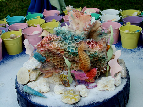 Edible white chocolate seascapes  with edible sea turtles, tropical fish, seahorses, coral and shells can be customized to include the elements you want.