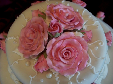 Sugar paste rose topper in close up view.