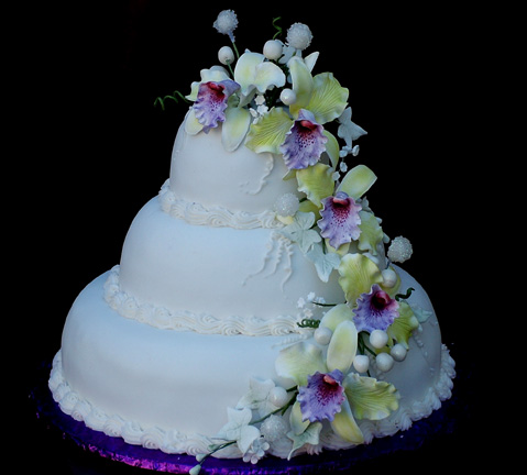 Among the cascading handmade sugar orchids are sugar crystal covered pearls.  This elegant cake serves 100 guests.  You can have different orchid types & colors, if desired.